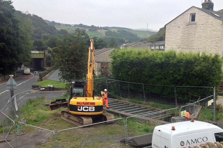 Photo: The crane was parked up for several days before work commenced on dredging our nearby culvert. £££ no doubt!