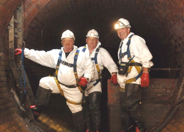 Photo: Three sewer flushers down a London sewer. Source: Thames Water.