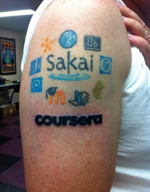 Photo: Dr Chuck's platform tattoos! Source: Coursera.